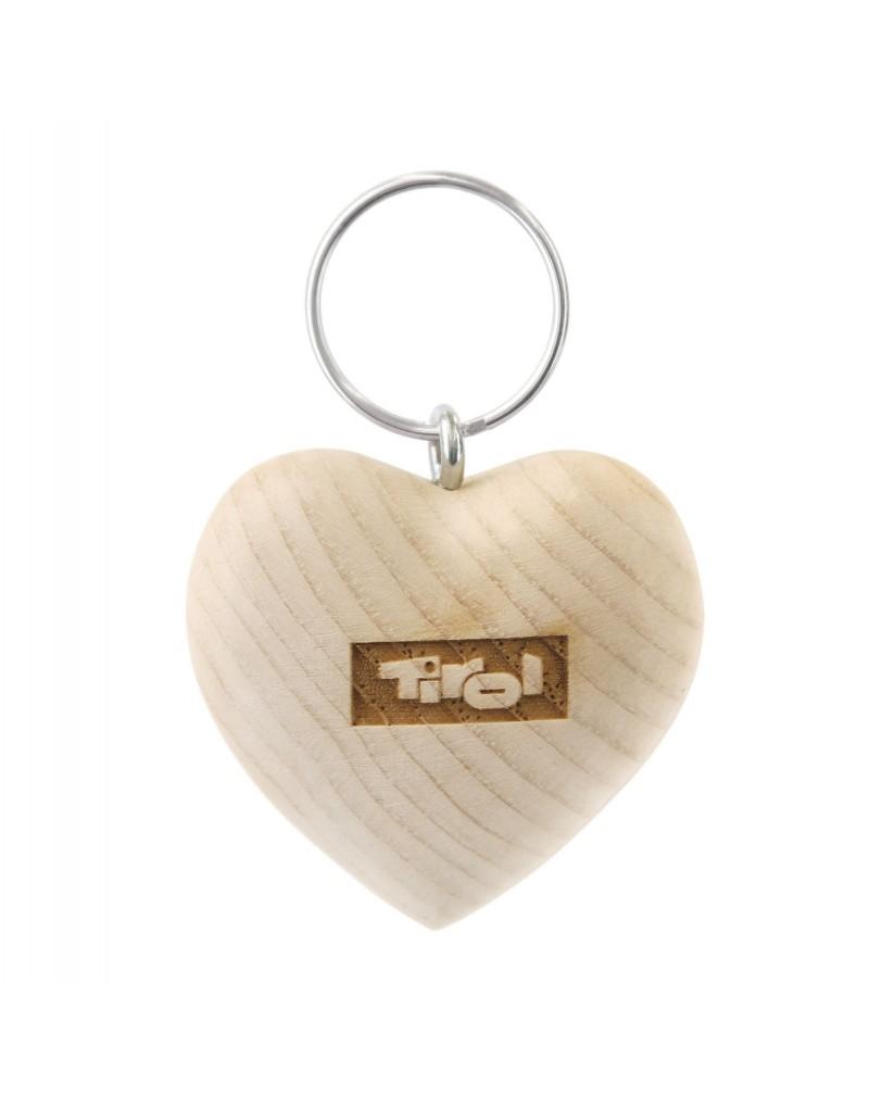"""Jedes Stück ein Unikat: Dieser Schlüsselanhänger in Herzform wird aus Tiroler Zirbenholz gefertigt. Durch die unterschiedlichen Holzmaserungen ist jedes Stück individuell und verändert im Laufe der Zeit zusätzlich die Farbe. Außerdem behält die seltene Holzart im verarbeiteten Zustand über viele Jahre ihren natürlichen Duft.    -Schlüsselanhänger aus heimischem Zirbenholz -in Tirol von einem heimischen Betrieb gefertigt -mit Tirol-Logo  -""""Tiroler Madl""""- Gravur auf der Rückseite"""