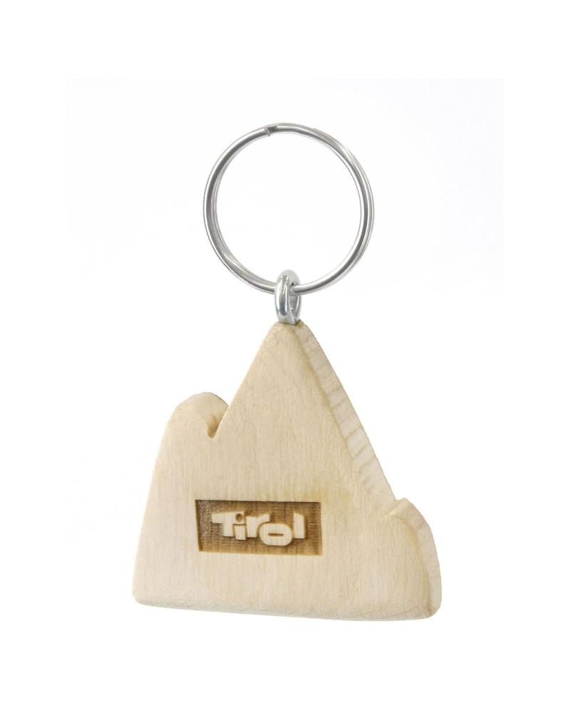 """Ob als originelles Souvenir oder als persönlicher Glücksbringer: Dieser Schlüsselanhänger aus Tiroler Zirbenholz ist besonderes Produkt. Der Holzanhänger wird im Tiroler Pitztal von einem heimischen Betrieb gefertigt, dabei ist jedes Stück ein Unikat - jede Holzmaserung unterscheidet sich, zusätzlich verändert sich im Lauf der Zeit auch die Farbe. Außergewöhnlich ist auch der Duft: Durch die Verarbeitung behält das Zirbenholz auch nach vielen Jahren noch seinen unverkennbaren Geruch.    - Schlüsselanhänger aus Zirbenholz - mit """"Tiroler Bua""""-Schriftzug auf der Rückseite - mit graviertem Tirol-Logo"""
